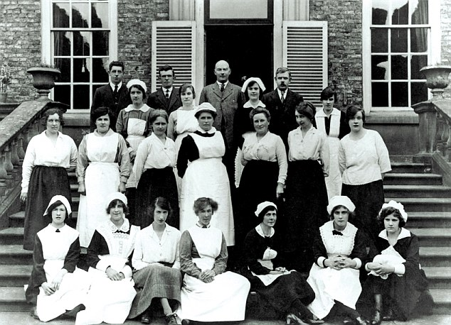 Erddig, a group portrait of staff on the garden steps